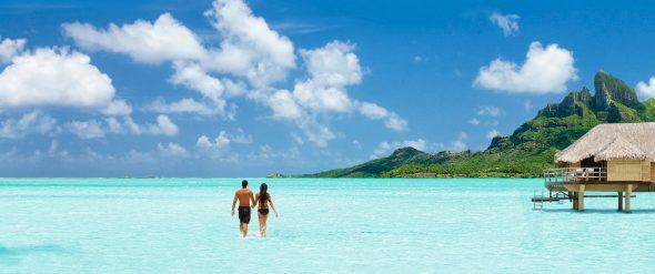 destination-tahiti-hero-couple-overwater-bungalow-bora-bora-2000x837