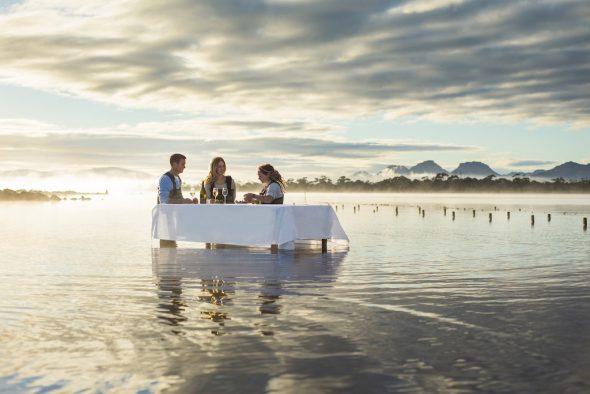 luxury travel dining on the beach